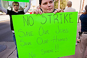 Nov. 9, 2009 -- PHOENIX, AZ: ASHLEY TURNER, who works in a Fry's grocery store in Glendale, AZ, and is opposed to an expected strike, pickets the offices of UFCW Local 99 in Phoenix Monday. Members of the United Food and Commercial Workers Union (UFCW) Local 99, based in Phoenix, AZ, is expected to go on strike against Fry's and Safeway grocery stores in Arizona on Friday, Nov. 13. The key sticking point in negotiations, which have broken down, is health care. Currently union members get health coverage for free, the grocery chains want to charge $5.00 per month. The stores have started hiring non-union replacement workers In anticipation of the strike. Unemployment in Arizona is around 10 percent and many union members have now come out against a strike fearing they could lose their jobs.    Photo by Jack Kurtz