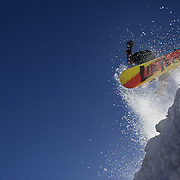 Snowboarder Blair Coggan, 22, from Western Australia takes to the air at The Remarkables Ski Fields, Queenstown, New Zealand during a session with 'The Air Bag'  a large inflatable airbag which breaks the fall of the participant on landing and allows valuable experience and a training aid for Aerial skiers and snowboarders. Queenstown, South Island, New Zealand, 18th July 2011
