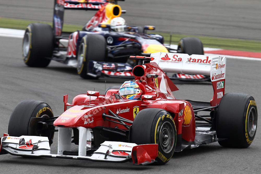 Fernando Alonso (Ferrari) leads Sebastian Vettel (Red Bull-Renault) in the 2011 German Grand Prix at the Nurburgring. Photo: Grand Prix Photo
