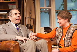 "© Licensed to London News Pictures. 25/01/2013. London, England. L-R: Rowan Atkinson as St. John Quartermaine and Felicity Montagu as Melanie Garth. Rowan Atkinson stars as St. John Quatermaine in ""Quartermaine's Terms"" at the Wyndham's Theatre, London. The tragicomic play was written by Simon Gray; direction by Richard Eyre. Bettina Strenske/LNP"