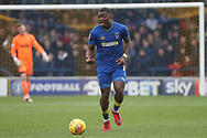 AFC Wimbledon defender Deji Oshilaja (4) bringing the ball out of defence during the EFL Sky Bet League 1 match between AFC Wimbledon and Blackpool at the Cherry Red Records Stadium, Kingston, England on 20 January 2018. Photo by Matthew Redman.