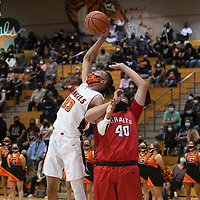 Gallup's Kohanon Atazhoon (23) grabs a rebound over Grants' Joshua Canaba (40) Tuesday night at Gallup High School in Gallup.