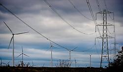 Wind turbines and electricity pylons on the Black Law Wind Farm, South Lanarkshire, Scotland<br /> <br /> (c) Andrew Wilson | Edinburgh Elite media