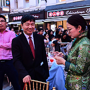 Chinese Minster 童学 (2nd L Mr. Tong Xuejun)黄萍 (Ping Huang)and the Chinese Consular attend the Moon festival - The big feast for the chinese community and the 70th Anniversary of China at Chinatown Square on the 15th September 2019, London, UK.