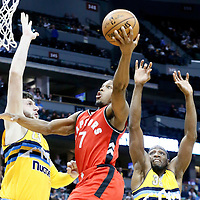 18 November 2016: Toronto Raptors guard Kyle Lowry (7) goes for the layup past Denver Nuggets forward Kenneth Faried (35) and Denver Nuggets center Jusuf Nurkic (23) during the Toronto Raptors 113-111 OT victory over the Denver Nuggets, at the Pepsi Center, Denver, Colorado, USA.