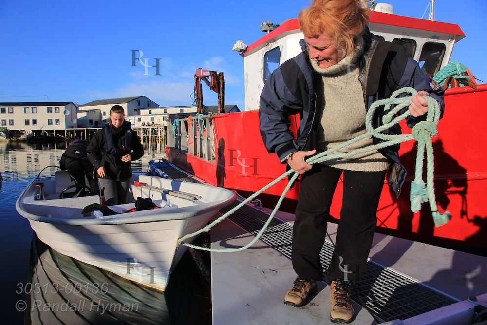 Andrine Klausen and her teacher, Kirsten Wollan, get ready to cast off and fish cod for dinner in the town of Ingoy on Ingoya island, Finnmark, Norway.
