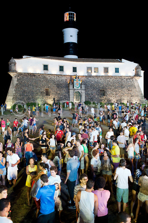 FIFA official fan fest in Salvador da Bahia, crowds gathered with Barra lighthouse in view, Brazil during the World Cup 2014.