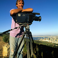SOUTH AFRICA.  Film maker Michael Graber (MR) films above Cape Town while waiting for flight to Antarctica.