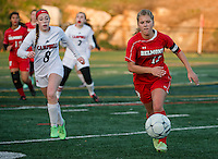 Belmont's Hannah Shirley charges the ball downfield ahead of Campbell's Autumn Thompson during NHIAA Division III Semi Final soccer at Laconia High School Tuesday afternoon.  (Karen Bobotas/for the Laconia Daily Sun)