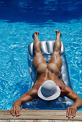 naked man on a float in a swimming pool