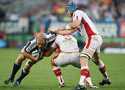 Schalk Burger of the Stormers is tackled by James Slipper of the Reds with Teammate James Horwill in support during the Super Rugby (Super 15) fixture between DHL Stormers and the Reds played at DHL Newlands in Cape Town, South Africa on 9 April 2011. Photo by Jacques Rossouw/SPORTZPICS