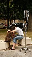 couple outside the hospital, taking a break....Hospital St. Louis, Paris
