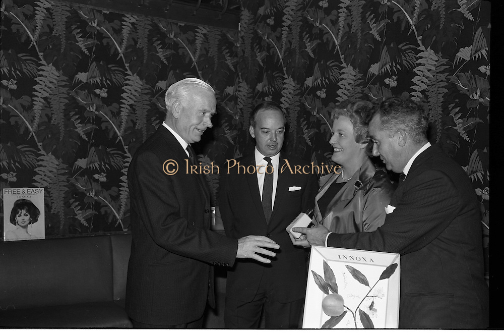 "Innoxa Reception At The Gresham Hotel..1963..02.10.1963..10.02.1963..2nd October 1963..At the Gresham Hotel, O'Connell Street, Dublin, Innoxa launched a new beauty range. The range,""Living Peach"", was introduced to members of the trade by Mr Bernard Mc Flynn,General Manager of Innoxa (England) Ltd. ..Image shows Mr W Storer, Innoxa,Product Co-ordinator, Mr Bernard Mc Flynn,General Manager,Innoxa,(England), ltd, Ms Eileen O'Boyle, Innoxa Consultant and Mr Desmond Flanagan, Sales Manager, Innoxa Ireland at the launch of the new beauty range."