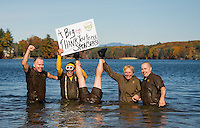 """The UPS Team hoists a big """"Thank You"""" sign during Saturday afternoons 11th annual Turkey Plunge into Lake Opechee for the Salvation Army.  (l-r) Bill Peck, Mark Emery, Jim Gentile, Claire Cantin and Chris Gallagher.  (Karen Bobotas/for the Laconia Daily Sun)"""