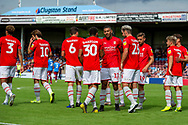 Swindon Town celebrate as Keshi Anderson of Swindon Town makes it 0-2 during the EFL Sky Bet League 2 match between Scunthorpe United and Swindon Town at Sands Venue Stadium, Glanford Park, Scunthorpe, England on 3 August 2019.