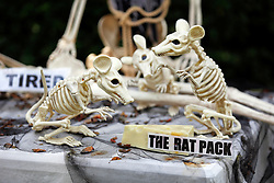30 October 2015. New Orleans, Louisiana.<br /> The Skeleton Krewe mansion on St Charles Avenue at the corner of State Street draws crowds with its satirically spooky Halloween decorations. The Rat Pack.<br /> Photo©; Charlie Varley/varleypix.com