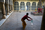 Boys play cricket inside one of the buildings of The Surya Mandir (known as the Monkey Temple), Jaipur, India