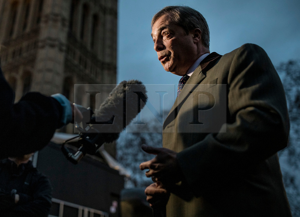 © Licensed to London News Pictures. 15/01/2019. London, UK. Former UKIP leader Nigel Farage gives an interview on College Green as MPs continue to debate Prime Minister Theresa May's proposed Brexit deal. Parliament will vote on the deal this evening. Photo credit: Rob Pinney/LNP