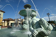 An ornate fountain sits among the restaurants and shops located at the Dellagio Plaza shopping center in the Dr. Phillips neighborhood of Orlando, Fla., Friday, July 10, 2015. (Phelan M. Ebenhack via AP)