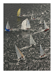 Sailing - The 2007 Bell Lawrie Scottish Series hosted by the Clyde Cruising Club, Tarbert, Loch Fyne..Brilliant first days conditions for racing across the three fleets..Colin MacDonald's 1720 White Tiger gybes Fleet Aerial Tiso Race course downwind sportboat fleet.SB3 Sonar.