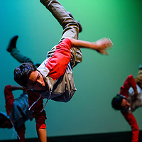 051515       Cable Hoover<br /> <br /> Simon Rodriguez and other break dancers kick into a hand stand during the Foundations of Freedom annual recital Friday at El Morro Theatre.