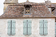 Traditional medieval old stone architecture and shutters in 13th Century bastide fortified town of Eymet in Aquitaine, France