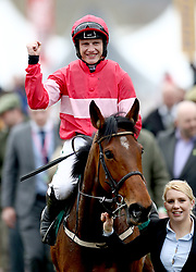Jockey Paul Townend celebrates after winning the Trull House Stud Mares' Novices' Hurdle with horse Laurina during St Patrick's Thursday of the 2018 Cheltenham Festival at Cheltenham Racecourse.