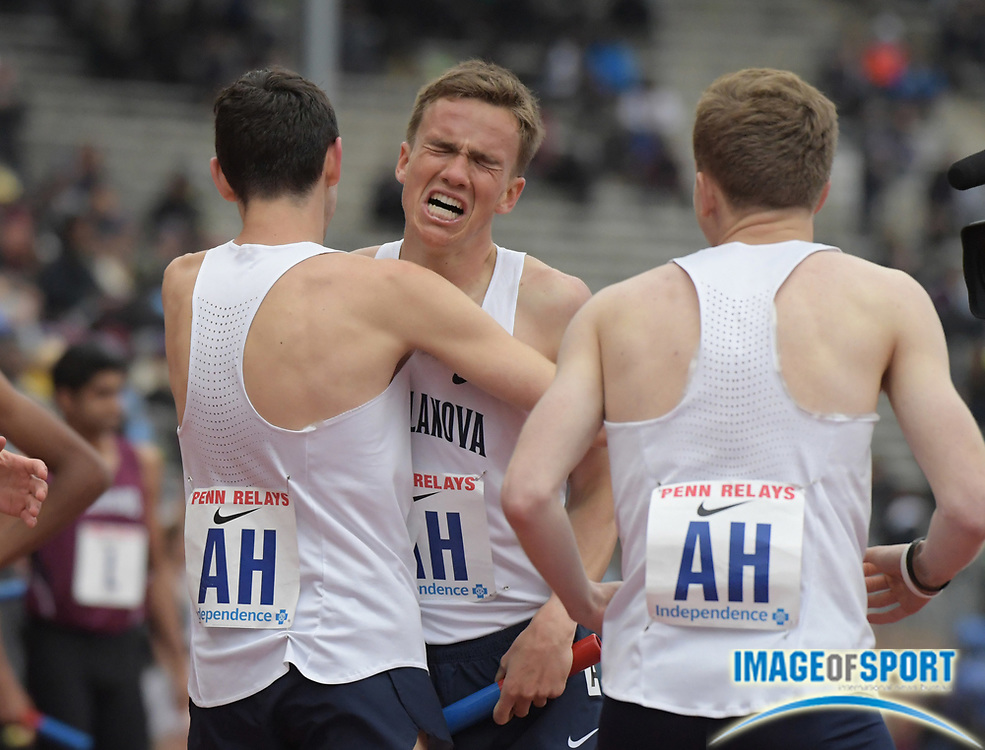 Apr 27, 2018; Philadelphia, PA, USA; Casey Comber (center) celebrates with Ben Malone (left) and Ville Lampinen after running the 1,600m anchor leg on the Villanova distance medley relay that won  the  Championship of America race in 9:34.97 during the 124th Penn Relays at Franklin Field.