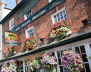 Exterior sign and floral display outside the Red Dragon pub in Marlborough, Wiltshire, England