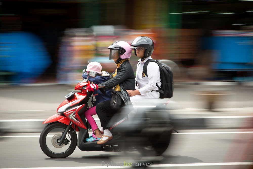 Motorbike in traffic, Yogyakarta, South Central Java, Java, Indonesia, Southeast Asia