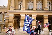 """21 NOVEMBER 2020 - DES MOINES, IOWA: Supporters of Donald Trump on the steps of the Iowa State Capitol during a """"Stop the Steal"""" rally. About 100 supporters of US President Donald Trump gathered at the Iowa State Capitol to rally in support of the President and in opposition to the outcome of the US election. They are a part of the """"Stop the Steal"""" movement which has spread across the US. This is the third week that there have been """"Stop the Steal"""" rallies across the US. Most independent observers and election officials, both Republican and Democratic, have said the election was free and fair and that there was no election fraud.    PHOTO BY JACK KURTZ"""