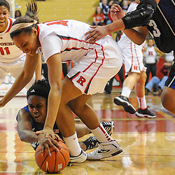 Seton Hall Pirates guard Jasmine Crew (23) dives to grab a loose ball away from Rutgers Scarlet Knights guard/forward Betnijah Laney (44) during second half NCAA Women's Basketball action between the Rutgers Scarlet Knights and Seton Hall Pirates at the Louis Brown Athletic Center. Rutgers defeated Seton Hall 62-39.