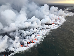 Handout photo of North facing view of the 1 km (0.6 mi) long ocean entry with multiple lobes of lava flowing into the sea. Kilauea Volcano, HI, USA, June 26, 2018. Photo by USGS via ABACAPRESS.COM