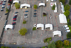 VIDEO AVAILABLE https://we.tl/t-FzsOTVRXLZ  © Licensed to London News Pictures. 16/09/2020. Chessington, UK. A Coronavirus testing centre set up in a car park at Chessington World of Adventures, south west of London, remains mostly quiet with only a trickle of people arriving for tests with six vehicles shown here (other vehicles (L) belong to staff). The Government have been criticised as people are facing delays getting tested for the virus. Photo credit: Peter Macdiarmid/LNP