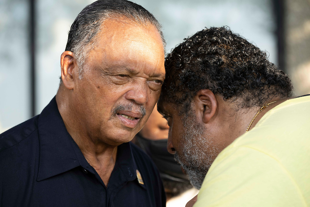 Rev.  JESSE JACKSON l, talks with WILLIAM BARBER  as voting rights groups march toward the Texas Capitol from north Austin on the third day of a 30-mile journey protesting Republican efforts to suppress votes nationwide and in Texas. Shifts of marchers trade off in an effort to combat oppressive Texas heat.