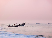 A fishing boat heads out in the early morning from Poovar Beach, near Trivandrum (Thiruvananthapuram), Kerala, India