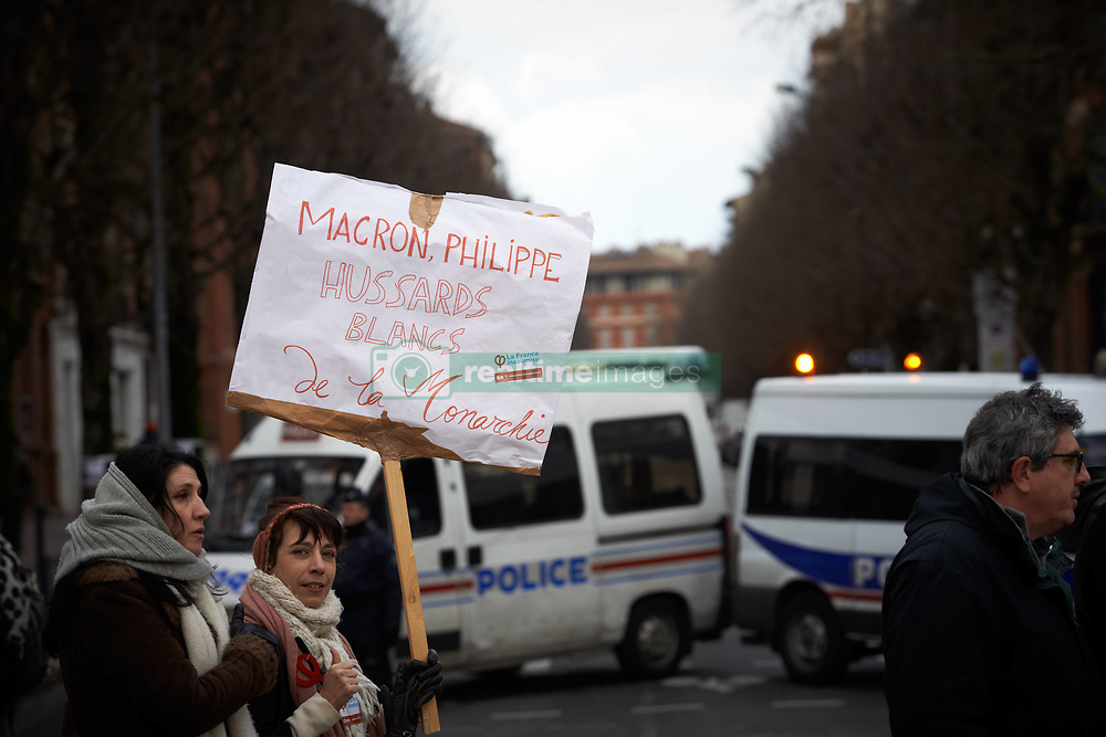 February 6, 2018 - Toulouse, France - A teacher carries a placard reading 'Macron and Philippe : white hussars of the monarchy' in front of riot policee (a reference to the nickname of professors called 'Black hussars of the Republic')More than 1000 students, highschool students, teachers demonstrated against the Vidal's law planned by the Macron's gouvernment.The Vidal law seeks to reform students' access to universities and changes the properties of the baccalaureate degree. Similar demonstrations were organized elsewhere. Toulouse. France. February 6th 2018. (Credit Image: © Alain Pitton/NurPhoto via ZUMA Press)