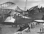 Young airmen swing far above the heads of their fellows in the Seaplane at Playland in 1932. Below the plane is the engine of the Miniature Railway. (Seattle Times Library)