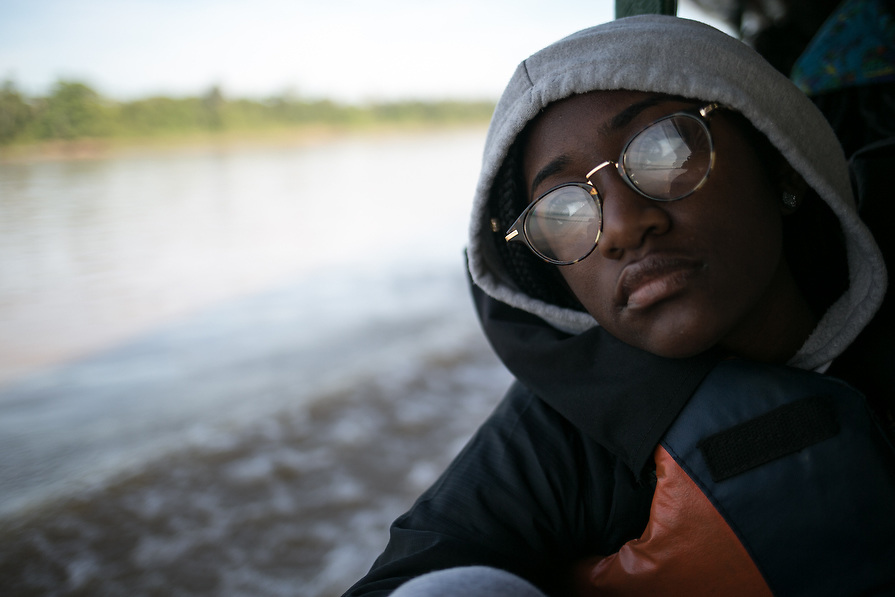 """""""I don't want to leave,"""" whispers Kendall Hall, 15, as the group makes their way down the Madre De Dios River as they leave the Amazon jungle."""