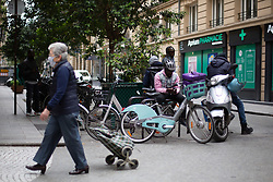 Cyclists delivery men in Paris on May 4, 2020, on the forty-ninth day of a strict lockdown in France, in place to attempt to stop the spread of the new coronavirus (COVID-19). Photo by Raphael Lafargue/ABACAPRESS.COM