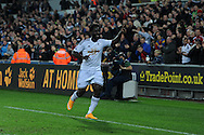 Wilfried Bony of Swansea city celebrates after he scores his sides 2nd  goal. Barclays Premier league match, Swansea city v Leicester city at the Liberty stadium in Swansea, South Wales on Saturday 25th October 2014<br /> pic by Andrew Orchard, Andrew Orchard sports photography.