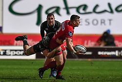 Scarlets' Scott Williams is tackled by Ospreys' Dan Lydiate - Mandatory by-line: Craig Thomas/Replay images - 26/12/2017 - RUGBY - Parc y Scarlets - Llanelli, Wales - Scarlets v Ospreys - Guinness Pro 14