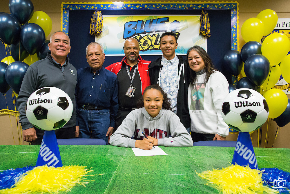 Sarina Bolden, her family, and Milpitas High School Soccer coach (left) pose with a duplicate National Letter of Intent to play soccer at the Loyola Marymount University during the NCAA National Signing Day event at Milpitas High School in Milpitas, California, on February 4, 2015. (Stan Olszewski/SOSKIphoto)