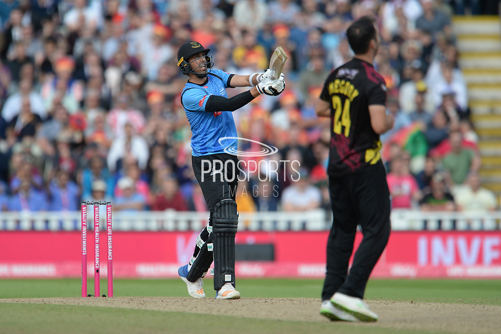David Wiese of Sussex hits a six off the bowling of Lewis Gregory during the Vitality T20 Finals Day semi final 2018 match between Sussex Sharks and Somerset County Cricket Club at Edgbaston, Birmingham, United Kingdom on 15 September 2018.