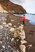 Beachcombing at Smugglers Cove, Santa Cruz island, Channel Islands National Park, California