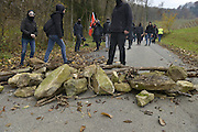 Nov. 11, 2015 - Wegscheid, Bavaria, Germany - GERMANY, Bavaria, Wegscheid; <br /> <br /> Changing tactics, as pro-refugee supporters run from police cordons along their route and take to the hills and farmland and create barriers across the road to hinder the progress of the police behind them.  Left wing rally in support of a pro-refugee, no borders policy as it makes its way from Spielfeld railway station up into the surrounding vineyards and mountain villages to encounter an opposing Right wing rally. The group is a loose co-ordination of Antifas and a local district anti-fascist group, comprised mainly of students and many others.  This alpine region lies on the border of the Slovenian town of Sentilj where a vast refugee processing centre has led to raised tensions around the issue.  <br /> ©Exclusivepix Media