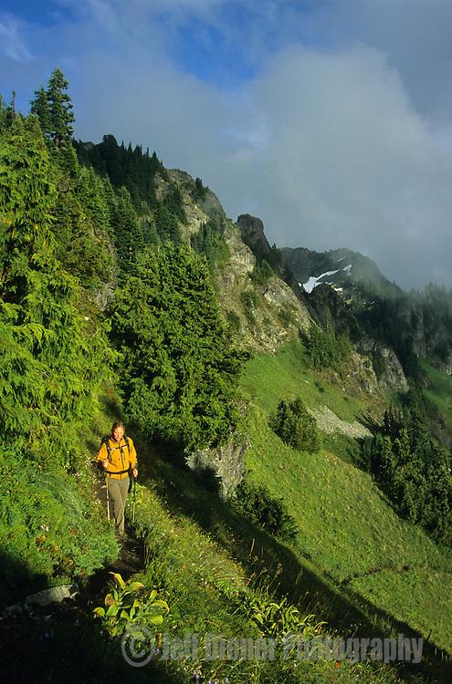 A young woman hikes in the Tatoosh Range, Mount Rainier National Park, Washington.