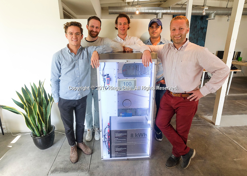 From left to right, Andrew Meyer, Tyler Gaul, Matt Riging, Suleman Khan, and Ken Lawshe, partner of Swell Energy with a Sonnen battery.<br /> (Photo by Ringo Chiu/PHOTOFORMULA.com)<br /> <br /> Usage Notes: This content is intended for editorial use only. For other uses, additional clearances may be required.