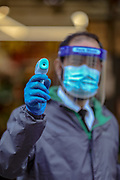 The entry health checker of the Loon Fung Chinese supermarket on Gerrard Street in London's Chinatown district pose to show temperature device aiming before he starts his shift to check the temperature of the customers before entering the shop to help curb the spread of Coronavirus outbreak on Monday, May 4, 2020. <br /> What started as an epidemic mainly limited to China has now become a truly global pandemic. Outside of China, there have been over 3,402,126 cases and over 247,107 deaths, according to the John Hopkins University Covid-19 dashboard, which collates information from national and international health authorities. The disease has been detected in at least 187 countries and territories, with Italy, Iran, Spain and the US lately experiencing the most widespread outbreaks outside of China. In the UK, there have been 186,599 confirmed cases and 28,446 deaths until the 3rd of May. (Photo/ Vudi Xhymshiti)