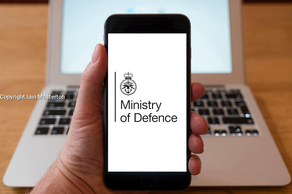 Using iPhone smartphone to display logo of the Ministry of Defence, UK Government